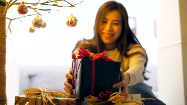 getting gift - christmas present stock videos and b-roll footage