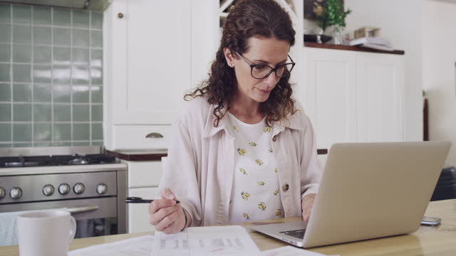 getting her household finances in order - life insurance stock videos & royalty-free footage