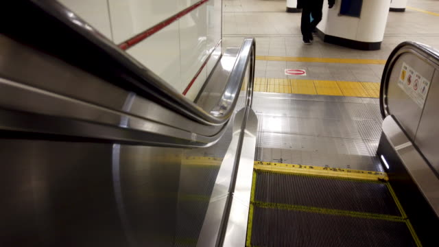 getting off escalator - stair lift stock videos and b-roll footage