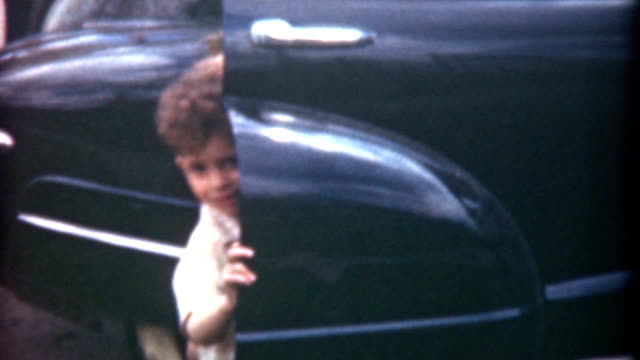 getting out of car 1959 - sibling stock videos and b-roll footage