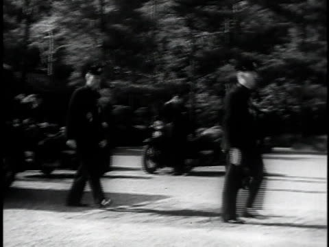 getting out of car / walking up stairs / hirohito and soldiers walking toward camera / ms hirohito in uniform with medals attached - kaiser hirohito von japan stock-videos und b-roll-filmmaterial