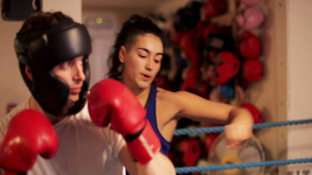 getting proper punching form with woman instructor - female with group of males stock videos and b-roll footage