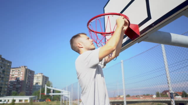 getting ready for new streetball season - adjusting stock videos & royalty-free footage