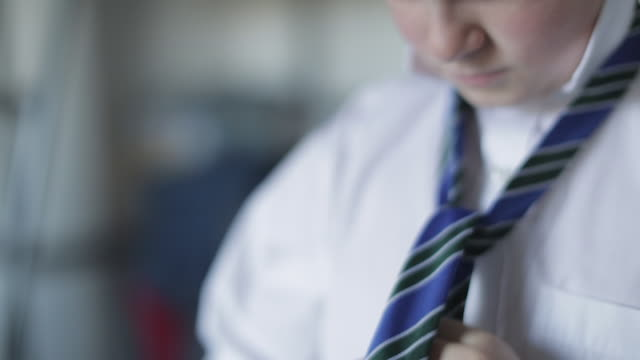 getting ready for school - boy tying his school tie - school uniform stock videos & royalty-free footage