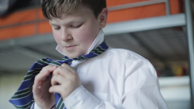 vídeos de stock, filmes e b-roll de getting ready for school - boy tying his school tie - shirt and tie