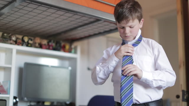getting ready for school - boy tying his school tie - schoolboy stock videos and b-roll footage