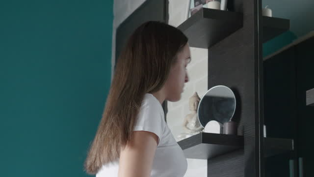 getting ready for school during covid-19 pandemic. teenager preparing herself in front of the mirror, putting her protective face mask, taking her backpack and going out to school. - adolescence stock videos & royalty-free footage