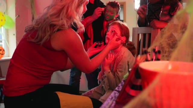 getting ready for the party - face paint stock videos & royalty-free footage
