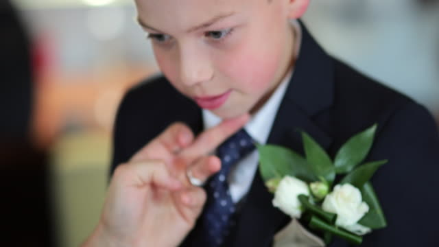 getting ready for the wedding - boutonniere stock videos and b-roll footage