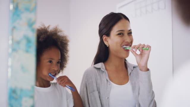 getting ready to brighten the world with our smiles - brushing teeth stock videos & royalty-free footage