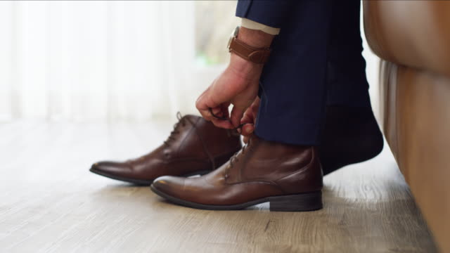 getting suited and booted before the big day - shoe stock videos & royalty-free footage