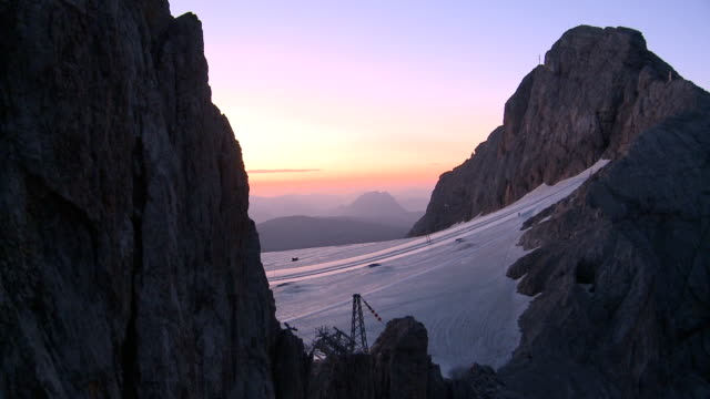 getting to glacier early morning - dachstein mountains stock videos and b-roll footage