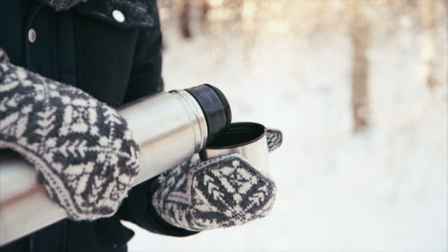 getting warm drink in winter forest - glove stock videos & royalty-free footage