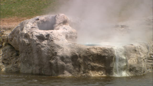 geyser at edge of snake river. available in hd. - snake river stock videos and b-roll footage