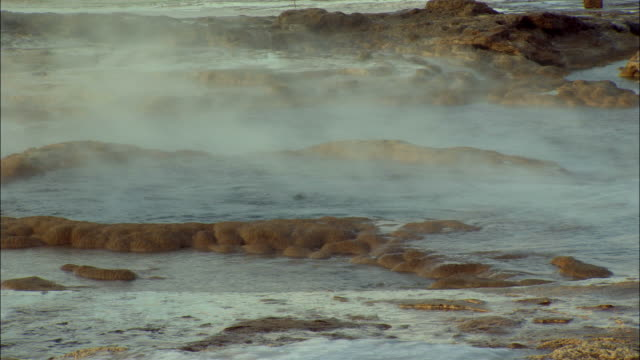 cu, geyser bubbling and erupting, haukadalur valley, iceland - geyser stock videos & royalty-free footage