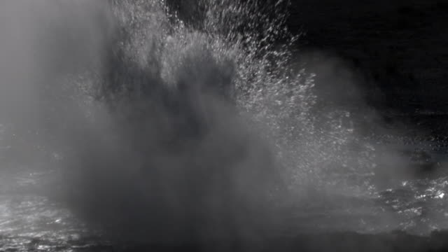 geyser erupts and splashes. - vulkanausbruch stock-videos und b-roll-filmmaterial