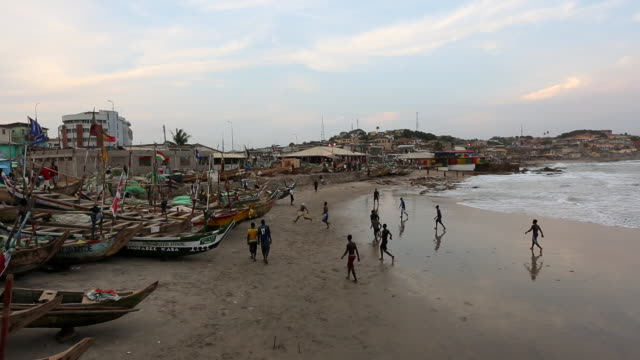 Ghanians play football on the beach