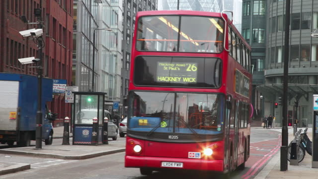 ws tu td gherkin and red london number 26 bus moving on bishopsgate / london, greater london, uk     - greater london stock videos & royalty-free footage