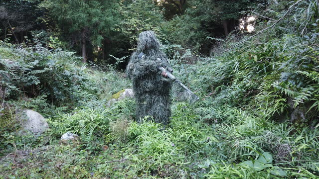 ghillie suit sniper in the jungle - camouflage stock videos & royalty-free footage
