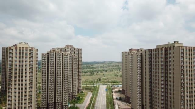 vídeos y material grabado en eventos de stock de ghost city of ordos in china - ciudad muerta