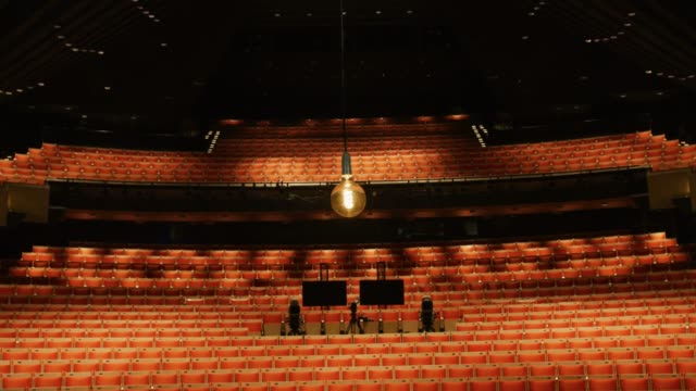 "ghost light"" hangs at the stage of the joan sutherland theatre at the sydney opera house on may 03, 2020 in sydney, australia. the sydney opera house... - オペラ座点の映像素材/bロール"