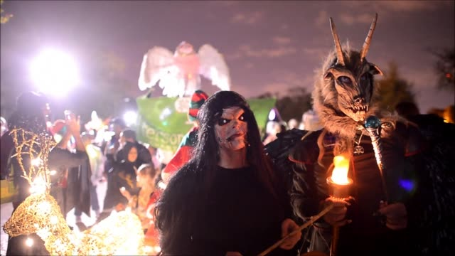 ghouls witches and magnificently lit sculptures and puppets gathered in baltimore on saturday for a halloween parade to the delight of costumed... - witch stock videos & royalty-free footage