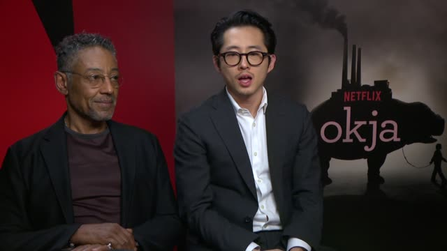 INTERVIEW Giancarlo Esposito Steven Yeun on saying something meaningful on escapism in the media at 'Okja' Interviews on May 20 2017 in Cannes France