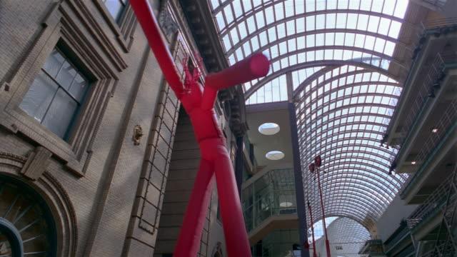la  pan giant balloon man in performing art complex  denver  colorado  usa - human representation stock videos & royalty-free footage