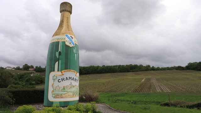 giant bottle of champagne decorates the entrance of a wine village on may 15, 2021 in cramant, france. located about 150 kilometers east of paris,... - local landmark stock videos & royalty-free footage