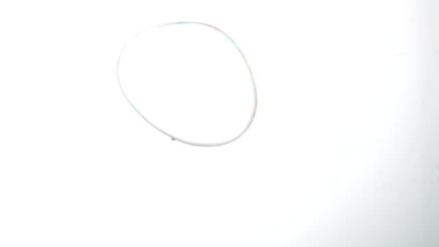 Giant bubble floating on white background