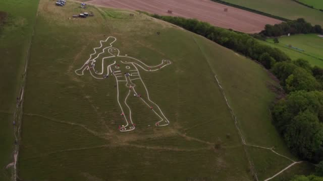 giant chalk figure that is thought to have loomed large on a country hillside since the 17th century is being given a makeover. the world famous... - national trust video stock e b–roll