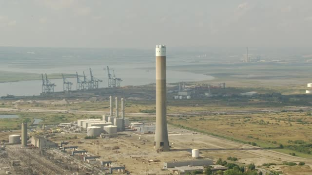 kent isle of grain demolition of giant concrete chimney / zoom in remains of chimney - kent england stock videos & royalty-free footage