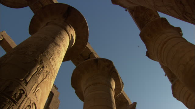giant columns surround the karnak temple at thebes, luxor, egypt. - temples of karnak stock videos & royalty-free footage