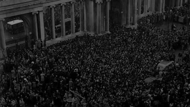 a giant crowd gathers for the funeral procession of king george v in london. - mourning stock videos & royalty-free footage
