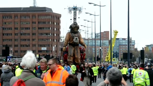 giant deep sea diver puppet, part of a street theatre production entitled sea odyssey, took a stroll through liverpool on friday to mark the 100th... - puppet stock videos & royalty-free footage