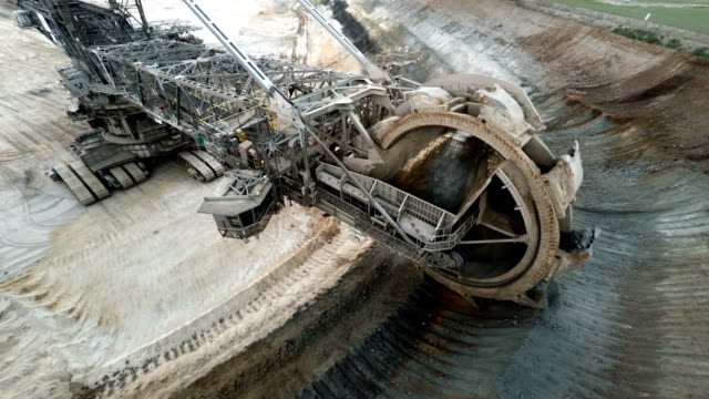 giant digging wheel of a bucket wheel excavator in coal mine - quarry stock videos & royalty-free footage