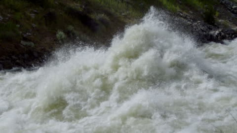 ms slo mo giant exploding wave on river / banks, idaho, united states - riverbank stock videos & royalty-free footage