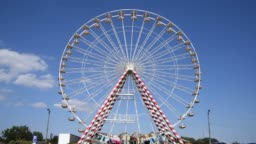 Giant ferris wheel with clear blue sky, Honfleur, Normandy, France