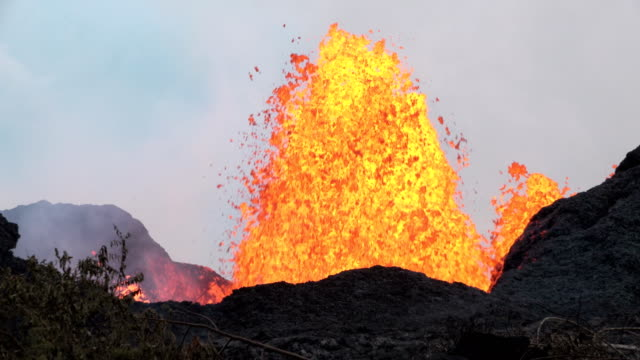 giant fissure spews massive lava fountain during incredible fissure eruption at kilauea volcano in hawaii in may 2018 - big island hawaii islands stock videos & royalty-free footage