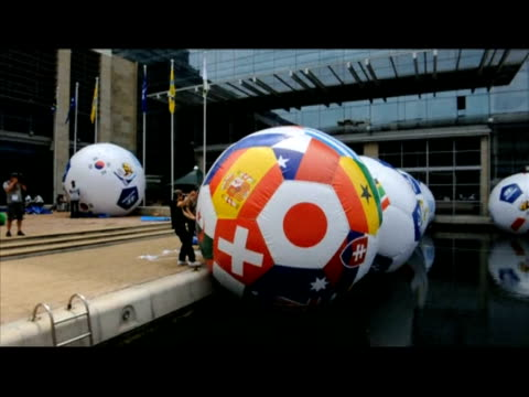 giant football balloons were floated on tuesday in a pool in front of the cape town international convention center where the 2010 fifa soccer world... - fifa world cup 2010 stock videos & royalty-free footage
