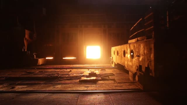 Giant hooks connect onto a cauldron containing molten steel at the Zaporizhstal steel plant owned and operated by Metinvest BV at their site in...