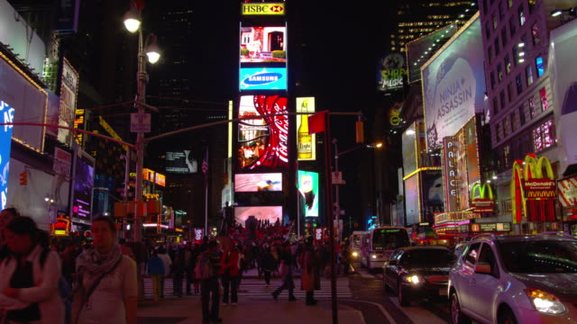 giant jumbotrons play videos in times square. - large scale screen stock videos & royalty-free footage