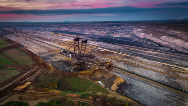 aerial: giant lignite surface mine - coal mine stock videos and b-roll footage