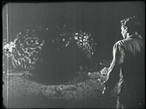 b/w 1954 giant lizard walks toward man (peter graves) - 1954 stock videos & royalty-free footage