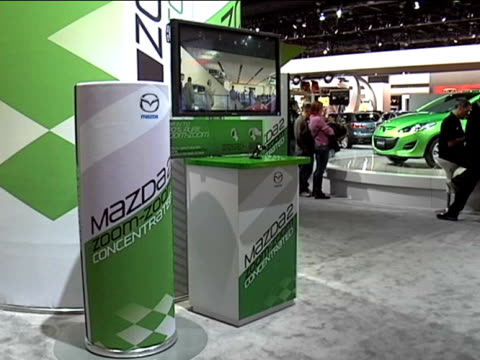 ws giant mazda zoomzoom concentrated soda can and video screen display / cu zoomzoom concentrated cans in vending machine zo to ws of soda machine... - anamorphic stock videos and b-roll footage