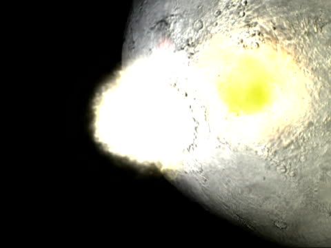 giant meteorite impact on the moon, forming an impact basin. some impact basins were subsequently filled by volcanic dark lava eruptions, which formed the dark lunar seas visible today.. - meteor weltall stock-videos und b-roll-filmmaterial