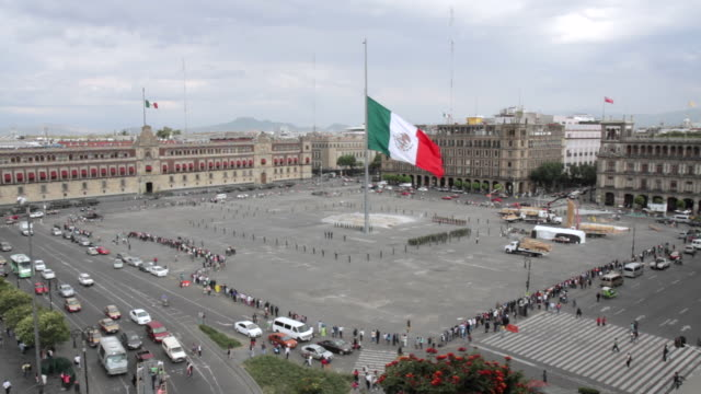 a giant mexican flag is lowered during a ceremony at the zocalo, mexico city. - zocalo mexico city stock videos & royalty-free footage