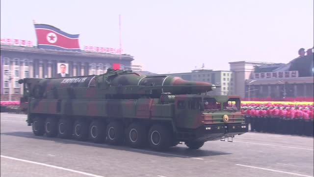 a giant missile that is considered to be a kn08 intercontinental ballistic missile carried out and displayed to the public for the first time during... - military parade stock videos and b-roll footage
