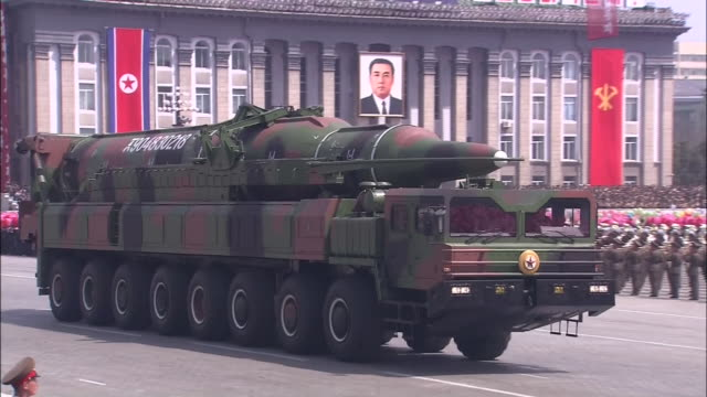 a giant missile that is considered to be a kn08 intercontinental ballistic missile carried out and displayed to the public for the first time during... - military parade stock videos & royalty-free footage