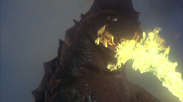 a giant monster waves its arms and exhales flames from its mouth. - claw stock videos & royalty-free footage